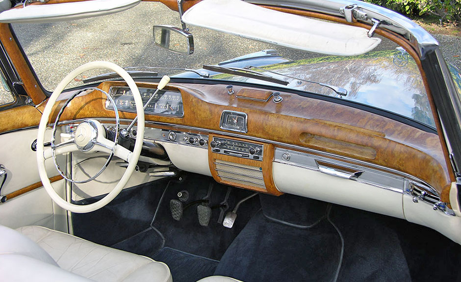 1954 220s dash ergonomically challenging. Massive wood panel anathema today for safety reasons.