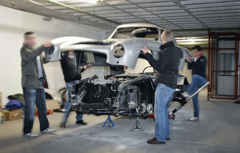 Is this the moment of truth in a Gullwing restoration when the body is once again joined to its chassis? Not quite. We're looking at the bowels of the Mercedes-Benz Used Parts Center and this particular Gullwing body is being crudely removed from its chassis to be crushed and disposed of.