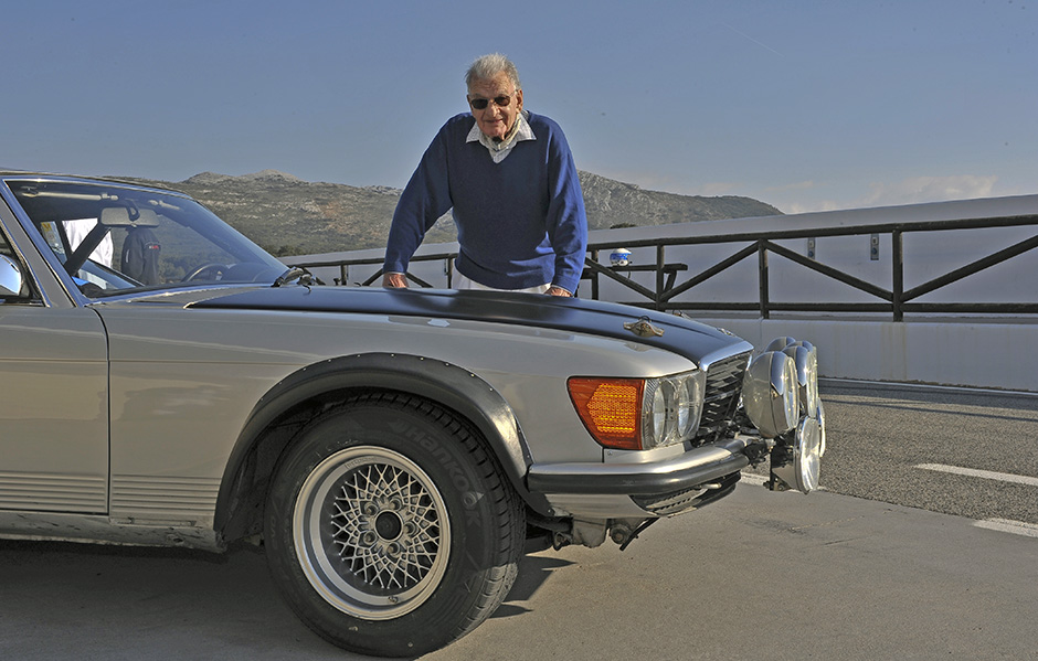 Mercedes-Benz' prolific engineer, Erich Waxenberger, poses recently with the 500SL he created for the 1981 World Championship Rally season. We see the '80s era BBS wheels, standard bumpers perhaps in aluminum and massive lamps for high speed night stages. Rocker and side moldings have been removed as has the production car's shallow front chin spoiler.