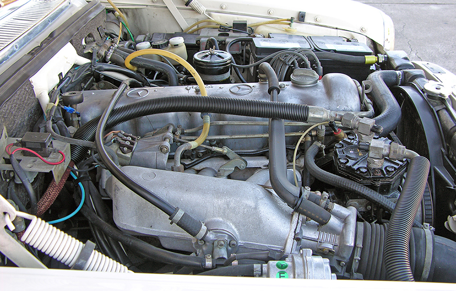 250CE stroke 8 coupe fuel injected engine